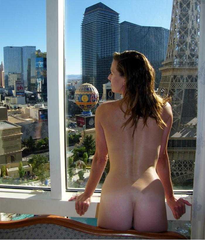 Nude in front window, deer caricature in bikini